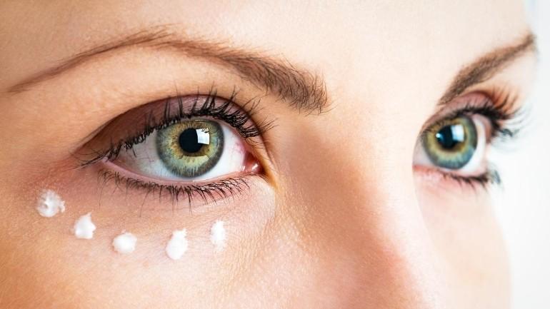 woman with cream below eye