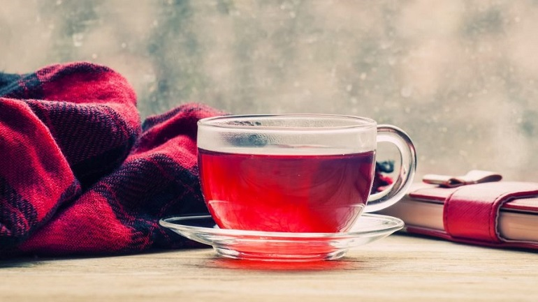 cup of red tea on table